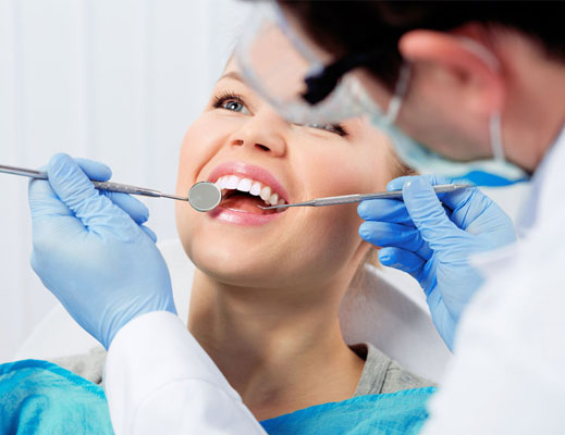 dentist-examining-female-patient